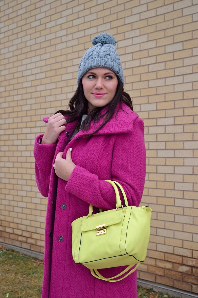 pink coat and neon purse