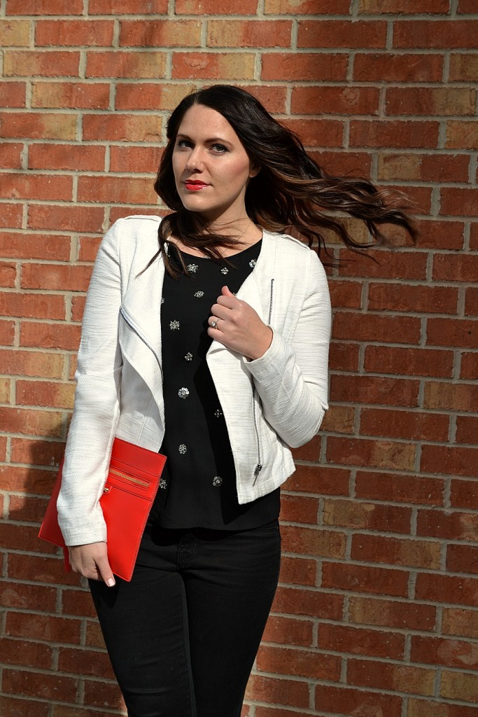classic black and white outfit with a pop of red
