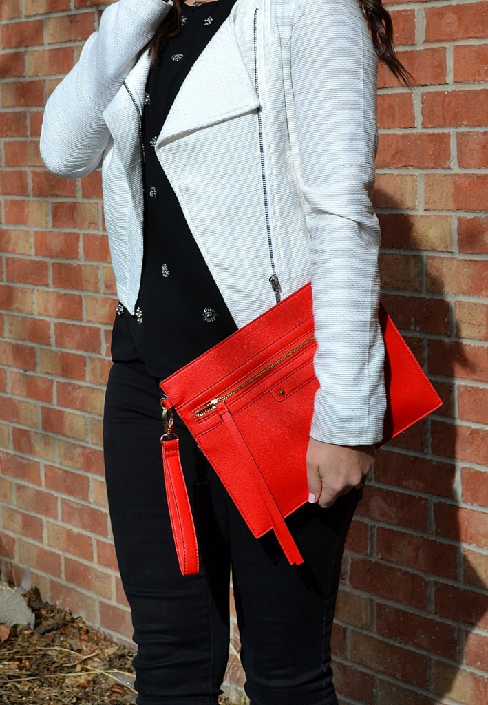 classic black and white outfit with red details