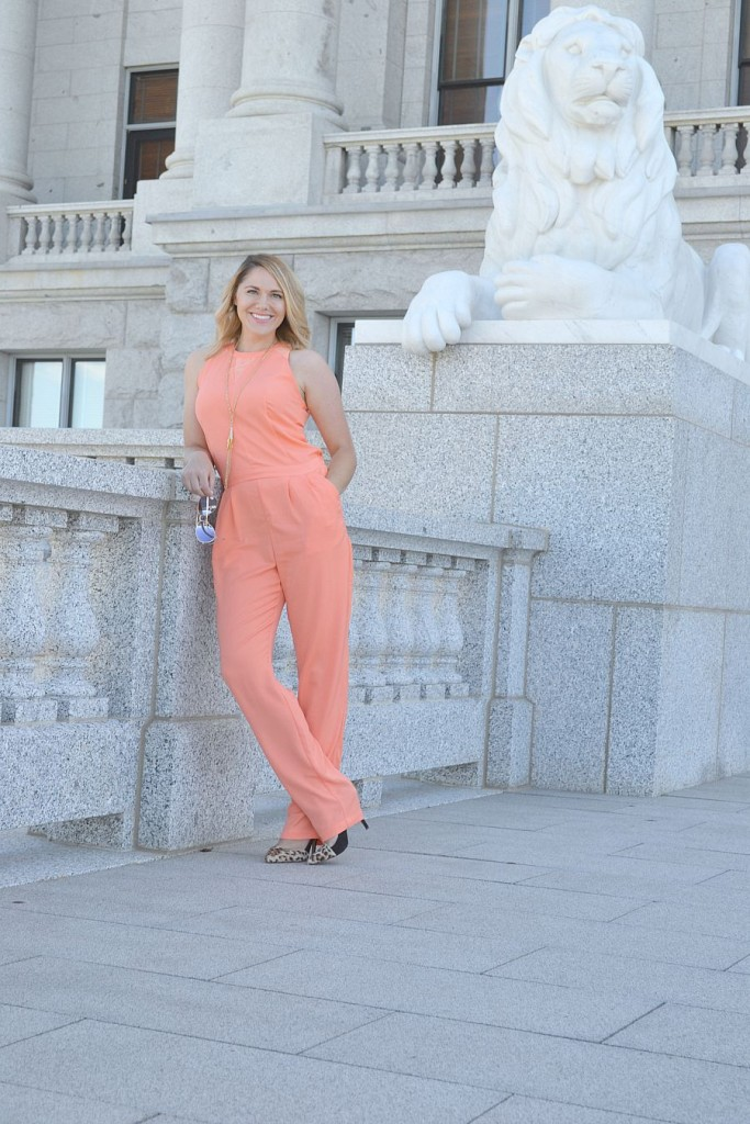 coral jumpsuit and leopard heels