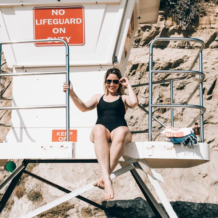 black one-piece swimsuit on lifeguard tower in Laguna, California // www.thefabblog.com